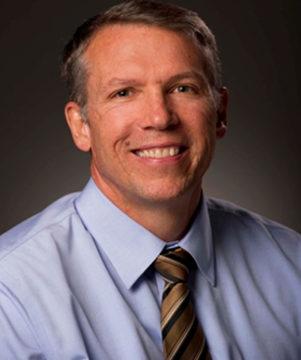 Dr. Gregg A. Okesson